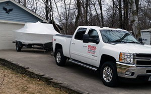 Moving your boat from your old house to your new house.